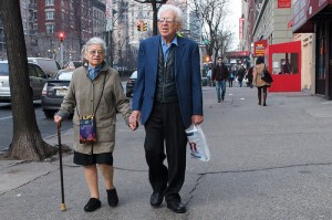 Elderly Couple Holding Hands On Date